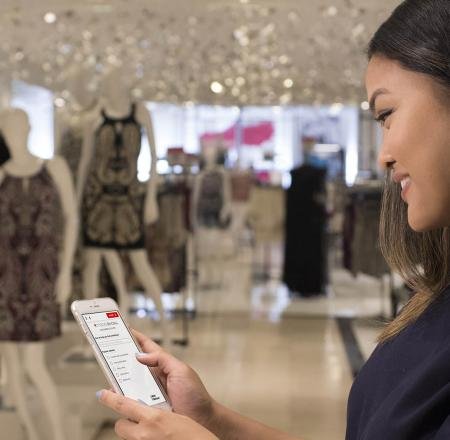 A Macy's team member tests out Macy's On Call, which allows customers to input questions in natural language about a participating store's product assortment. Photo: IBM