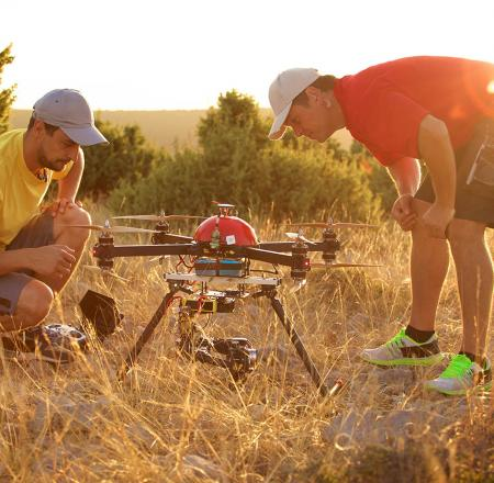 Two men prepare to fly a drone. Photo: iStockphoto