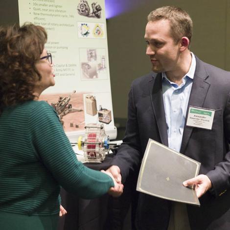 LiquidPiston CEO Alex Shkolnik accepts his company's award from AUVSI Executive Vice President Heather Lee. Photo: AUVSI