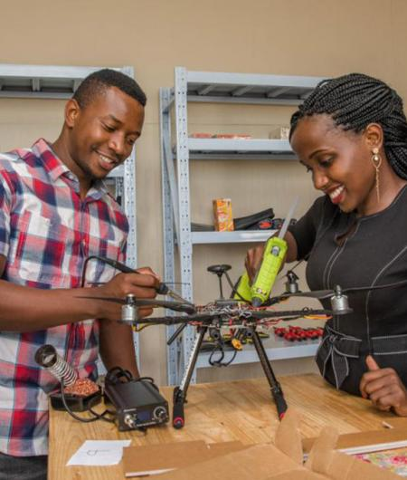 ADDA students Hope Chilunga (left) and Anne Nderitu attach a sensor to a drone. Photo: UNICEF/Moving Minds Multimedia