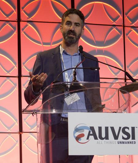 The Defense Innovation Unit's Orin Hoffman discusses DIU at AUVSI's Defense. Protection. Security conference in 2018. Photo: AUVSI