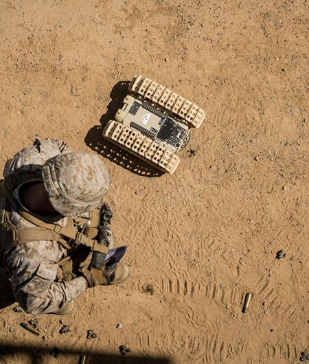 A U.S. Marine tests an unmanned ground robot. Photo: USMC