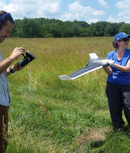 Dr. Holly Jones works with a drone to study a 4,000 acre prairie. Photo: Parrot