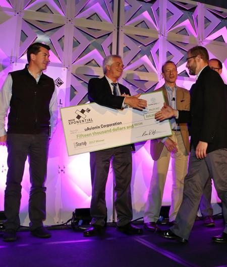 The winner of the 2017 Startup Showdown, uAvionix, accepts their award. Photo: Robb Cohen Photo & Video