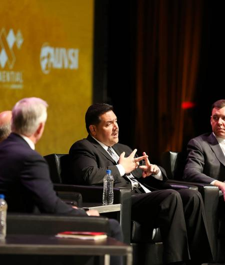 Andrew Velasquez III, managing deputy commissioner of the Safety and Security Division of CDA, second from right, and Matt Cornelius, EVP of Airports Council International - North America, discuss the task force at AUVSI Xponential 2019. Photo: Becphotogr
