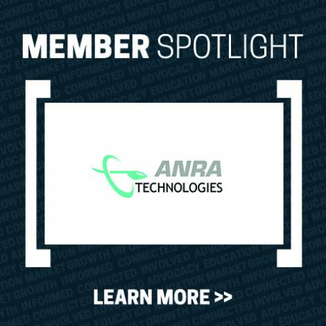 Member Spotlight tile - dark blue with white rectangle in middle with ANRA Technologies logo - light green oval with a stylized plane through it horizontally (just cockpit and a line behind it) with ANRA TECHNOLOGIES in gray and black