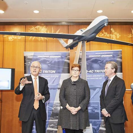 Northrop Grumman and Australian officials at a ceremony marking a Triton sale. Photo: Northrop Grumman