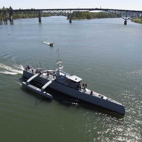 Sea Hunter, a medium-sized USV, gets underway on the Williamette River, Portland, Oregon, 2017, following a christening ceremony. The Navy would like more USVs of all sizes. Photo: U.S Navy/John F. Williams