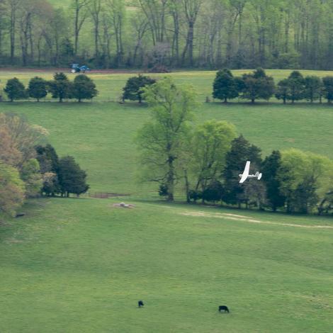 An AeroVironment Puma flies over Virginia farmland. Photo: MAAP