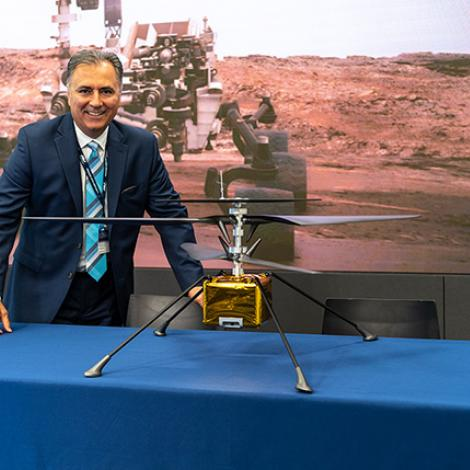 AV's CEO poses with a model of the Mars Helicopter. Photo: AeroVironment