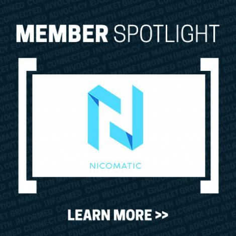 Member Spotlight tile with Learn More>> at the bottom and Nicomatic's logo in the middle (light blue and white N)