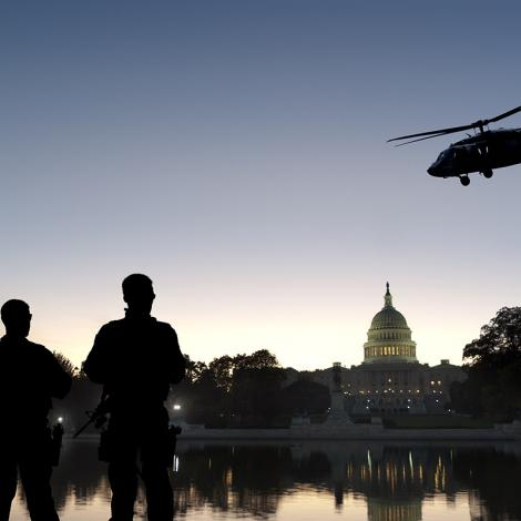 A stock photo of soldiers and a helicopter in front of the U.S. Capitol.